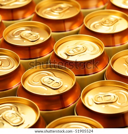 Plenty gold beer cans - stock photo