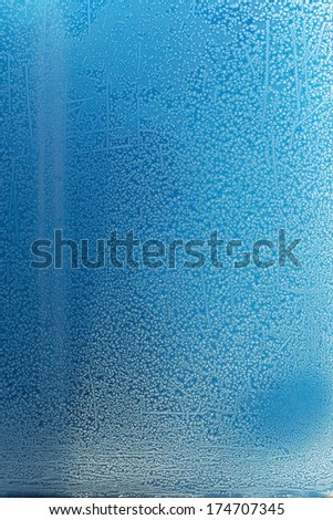 Plenty of natural crystals of frost on a window pane in winter. - stock photo