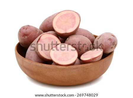 plenty of red fingerling potatoes in bowl  isolated on white  - stock photo