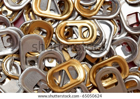 Plenty of ring-pulls, may be used as background - stock photo
