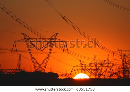 plenty of transmission towers during sunset - stock photo