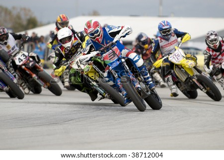 PLEVEN, BULGARIA - OCTOBER 11: Lorenzo Mariani leads the group into the first corner during FIM SuperMoto of Nations October 11, 2009 in Pleven, Bulgaria.