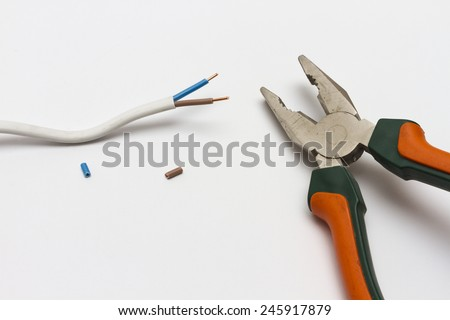 Pliers and electric cable stripped. - stock photo