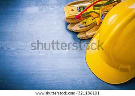 Pliers hard hat goggles construction level safety gloves. - stock photo