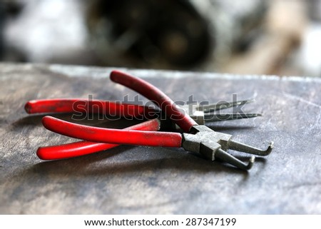 Pliers on table close up - stock photo