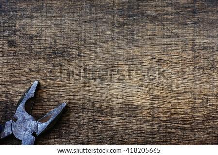 pliers on wood - stock photo