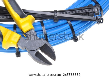Pliers with electrical cables and cable ties - stock photo