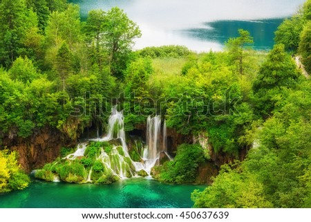 Plitvice Lakes National Park amazing emerald lakes and waterfalls, surrounded by forests in Croatia, nature background suitable for wallpaper or guide book - stock photo