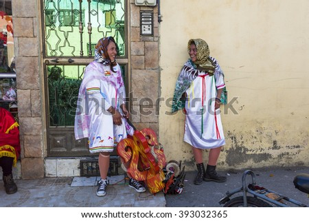 Pllaro, ECUADOR - FEBRUARY 6, 2016: Unknown locals dressed up participating in the Diablada, popular town celebrations with people dressed as devils dancing in the streets - stock photo