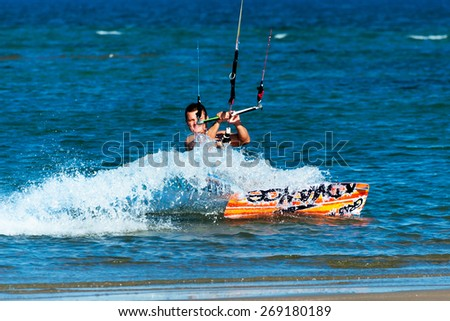 PLOCE, CROATIA - JUNE 11: Kitesurfer rides on the surfboard and enjoys the sea in Ploce, Croatia on June 11,2012. - stock photo