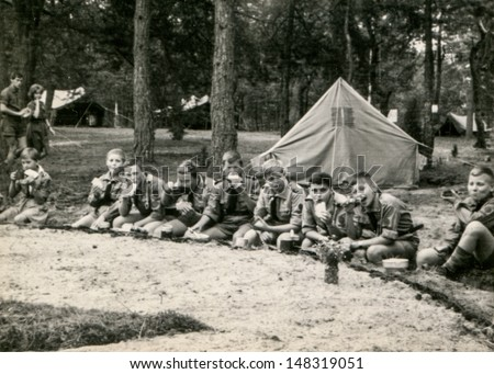 PLOCICZNO, POLAND, CIRCA 1957 - vintage photo of group of scouts during a summer camp, Plociczno, Poland, circa 1957 - stock photo