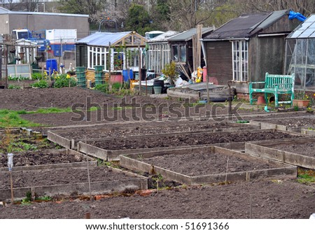 Plots in the allotment, with greenhouses and other buildings - stock photo