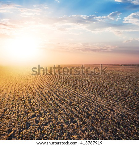 plough land at the quiet evening - stock photo