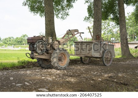 Plough tractor transforms to small wagon for carrying agriculture products.