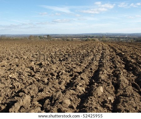 Ploughed Agricultural Land - stock photo