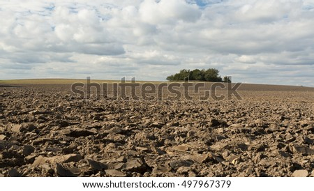 Ploughed field on a cloudy day