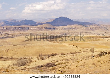 Ploughed winter fields near Clarens, South Africa with the Lesotho Highlands in the background. - stock photo