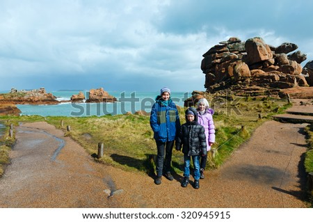 Ploumanach coast spring view ( Perros-Guirec, Brittany, France) and family tourist. The Pink Granite Coast.