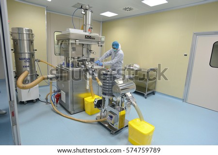 Plovdiv,Bulgaria - January 16, 2017 :  Operator with protective clothing inspecting a pharmaceutical plant
