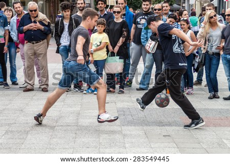 PLOVDIV, BULGARIA - MAY 29, 2015 - Demonstration of Panna - new urban game where the players should kick the ball between an opponent's legs - 23 May 2015. Part of the Move week event. - stock photo