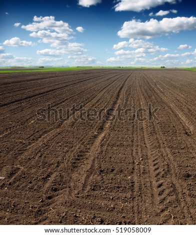 plowed field against the sky