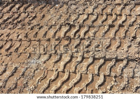 plowed field with tractor tyre track - stock photo
