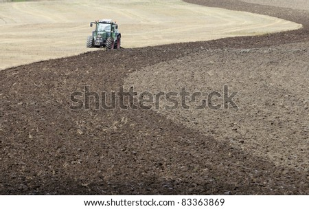 Plowing a field - stock photo