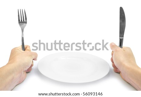 Plug and knife in hands on white background with plate - stock photo