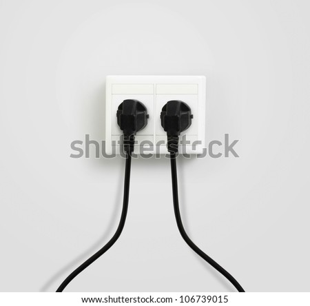 plug plugged in a socket - stock photo