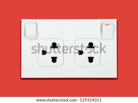 Plug socket on red background - stock photo