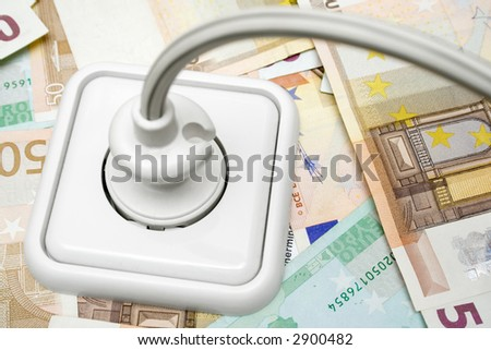 Plugged Cable on Money Background - stock photo