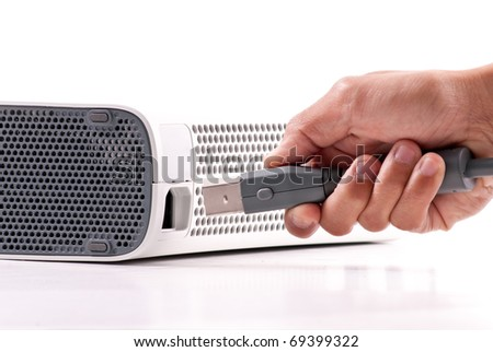 Plugging In Your Gaming Console - stock photo