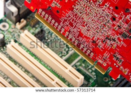 Pluging computer card to motherboard socket - stock photo