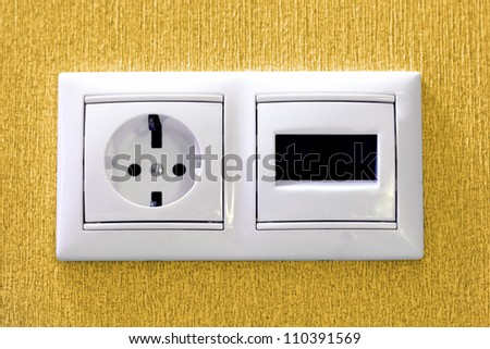 Plugs in electric and phone  socket - stock photo