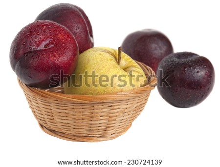 plum and Apple in basket isolated on white background