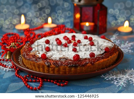 Plum cake with a  cranberry and filling from a jam