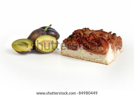 Plum cake with sliced plum - stock photo