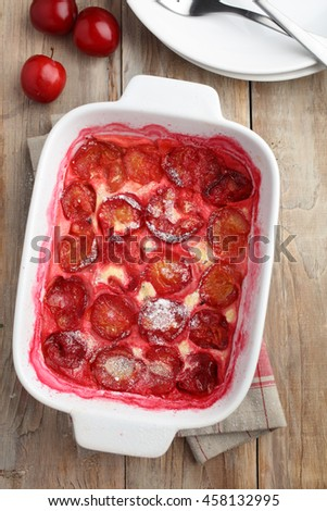 Plum clafoutis in a baking dish - stock photo