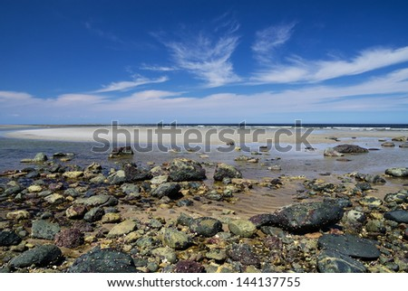 Plum Island beach from Sandy Point at low tide - stock photo