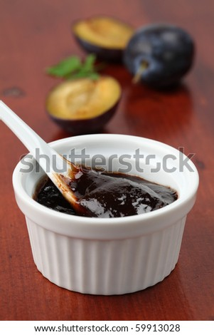 Plum jam and fresh plums. Shallow dof - stock photo