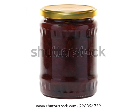 Plum jam in a glass jar isolated on white background - stock photo