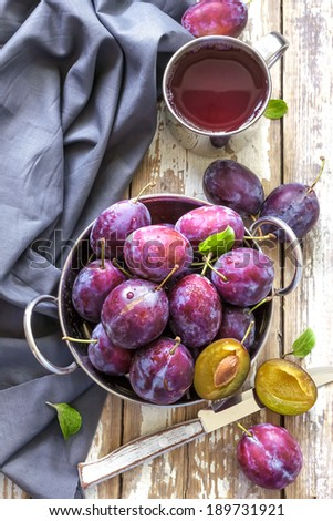 Plum juice - stock photo