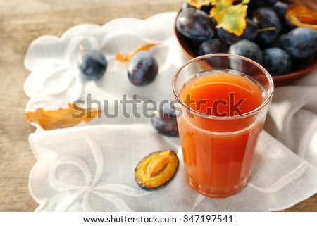 Plum Juice in a glass with fresh fruits - stock photo