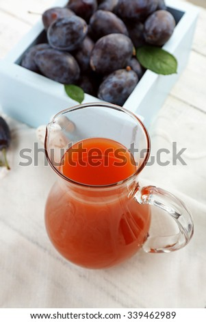 Plum Juice in a jar with fresh fruits - stock photo