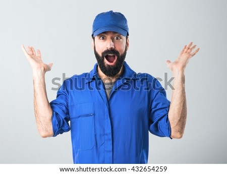 Plumber doing surprise gesture - stock photo