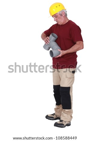 Plumber fitting pipe - stock photo