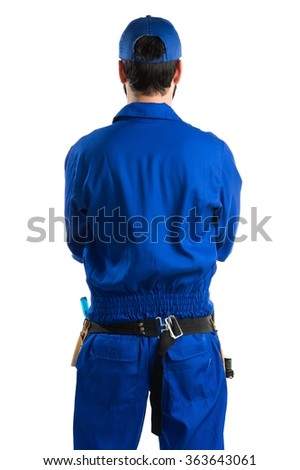 Plumber in back position - stock photo