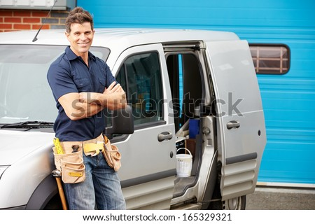 Plumber Or Electrician Standing Next To Van - stock photo