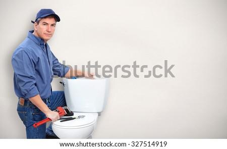 Plumber repairing toilet. Plumbing and renovation banner. - stock photo