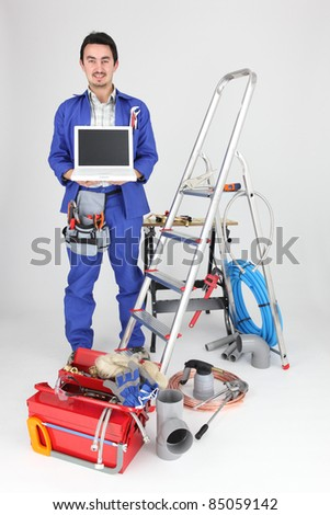 plumber showing computer - stock photo